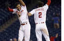 J.P. Crawford and Nick Williams celebrate